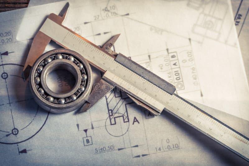 El llevar mecánico, calibrador y diagramas foto de archivo libre de regalías