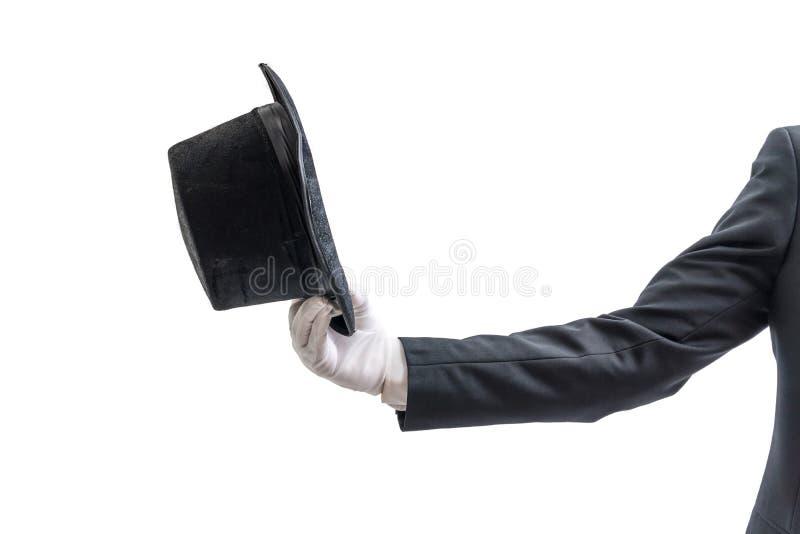 El mago o el ilusionista está mostrando el sombrero Aislado en el fondo blanco imagen de archivo libre de regalías