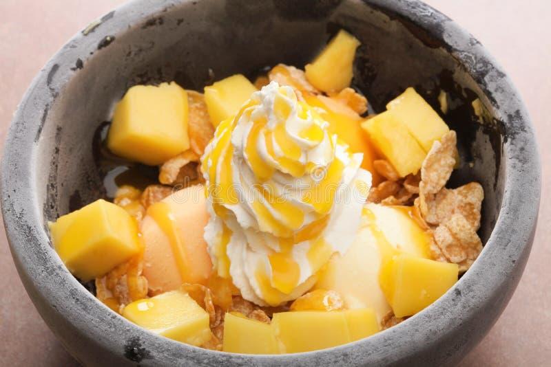 El mango de piedra del postre helado del mango de la acidez es perfecto al afte combinado fotos de archivo