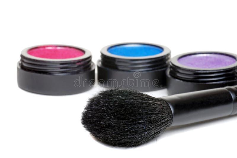 El maquillaje con se ruboriza cepillo fotos de archivo