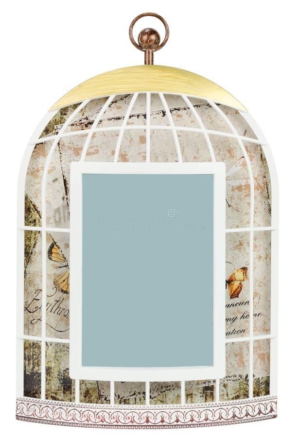 El marco de la foto le gusta una jaula de pájaros lamentable del vintage foto de archivo
