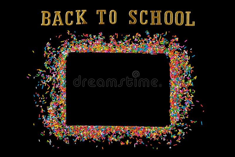 El marco de la frontera de colorido asperja en un fondo negro con el co fotografía de archivo