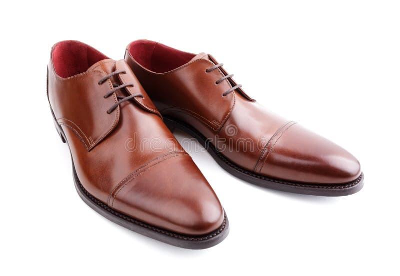 El marrón clásico sirve los zapatos de cuero fotografía de archivo libre de regalías