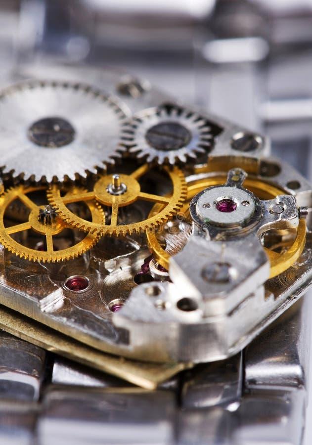 El mecanismo está de reloj desensamblado foto de archivo libre de regalías