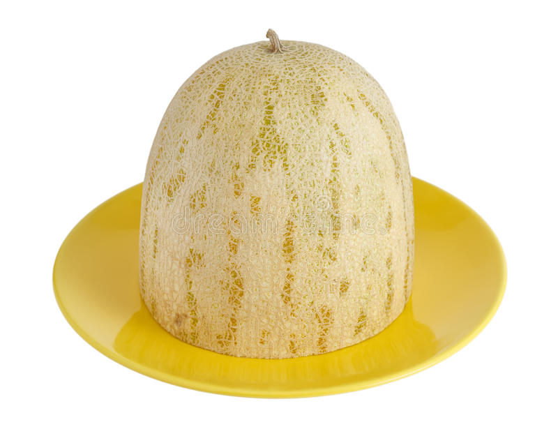 El melón del corte miente en un plato imagen de archivo libre de regalías