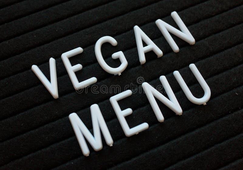 El menú del vegano en las letras sube imagen de archivo