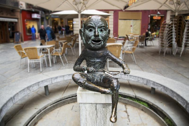 El Merma sculpture in Vic, Spain. VIC, SPAIN - DECEMBER 29, 2017: A view of the El Merma sculpture, depicting a popular character in the festivals of the city stock image
