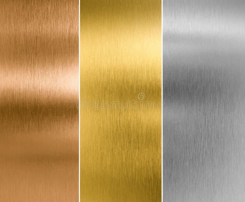 El metal de la plata, del oro y del bronce texturiza fondos fotos de archivo libres de regalías