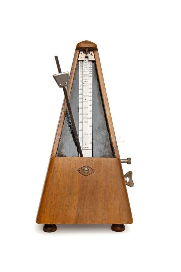 El metrónomo musical antiguo aisló fotografía de archivo