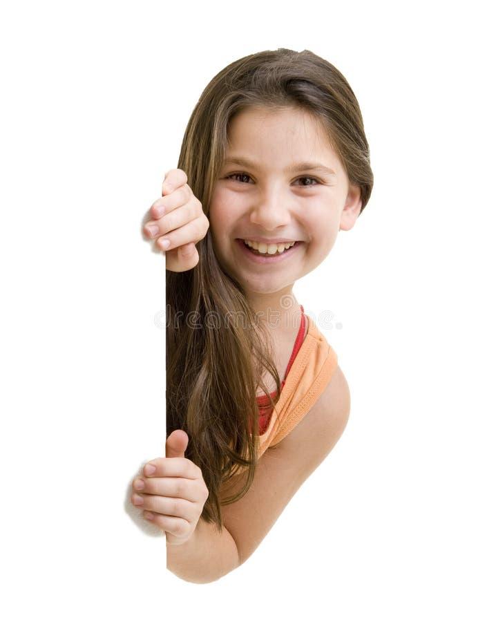 El mirar a escondidas de la chica joven fotografía de archivo libre de regalías