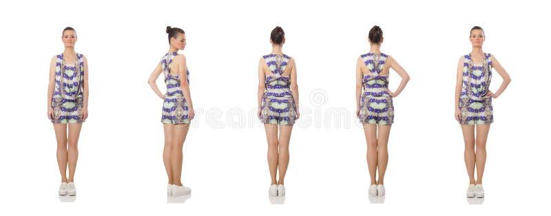 El modelo bonito que lleva el vestido de flores p?rpura aislado en blanco foto de archivo