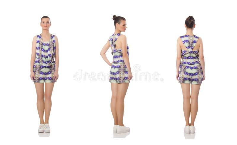 El modelo bonito que lleva el vestido de flores p?rpura aislado en blanco imagen de archivo
