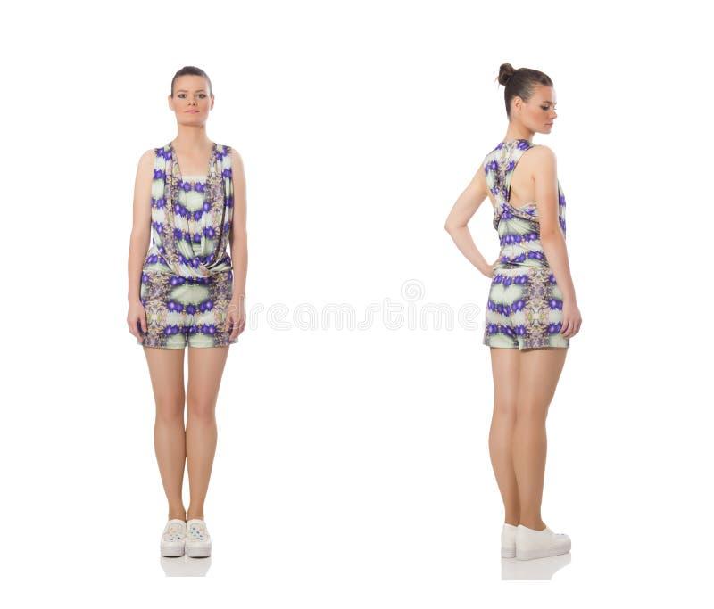 El modelo bonito que lleva el vestido de flores p?rpura aislado en blanco fotografía de archivo