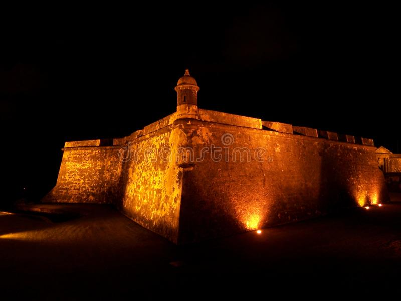 El Morro fort in San Juan Puerto Rico at night. Travel, tourism, puertorico, lit-up, illuminated, fortress, architecture, history, military, wall, tower royalty free stock photo
