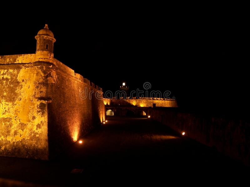 El Morro fort in San Juan Puerto Rico at night. Travel, tourism, puertorico, lit-up, illuminated, fortress, architecture, history, military, wall, tower royalty free stock photography