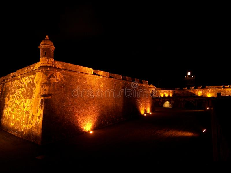 El Morro fort in San Juan Puerto Rico at night. Travel, tourism, puertorico, lit-up, illuminated, fortress, architecture, history, military, wall, tower stock image