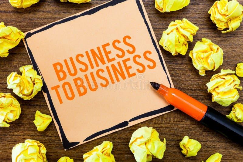 El mostrar de la nota de la escritura interempresarial Foto del negocio que muestra la transacción comercial entre dos negocios foto de archivo