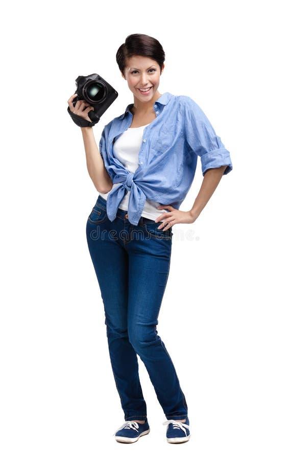 El muchacha-fotógrafo bonito toma las broches fotografía de archivo