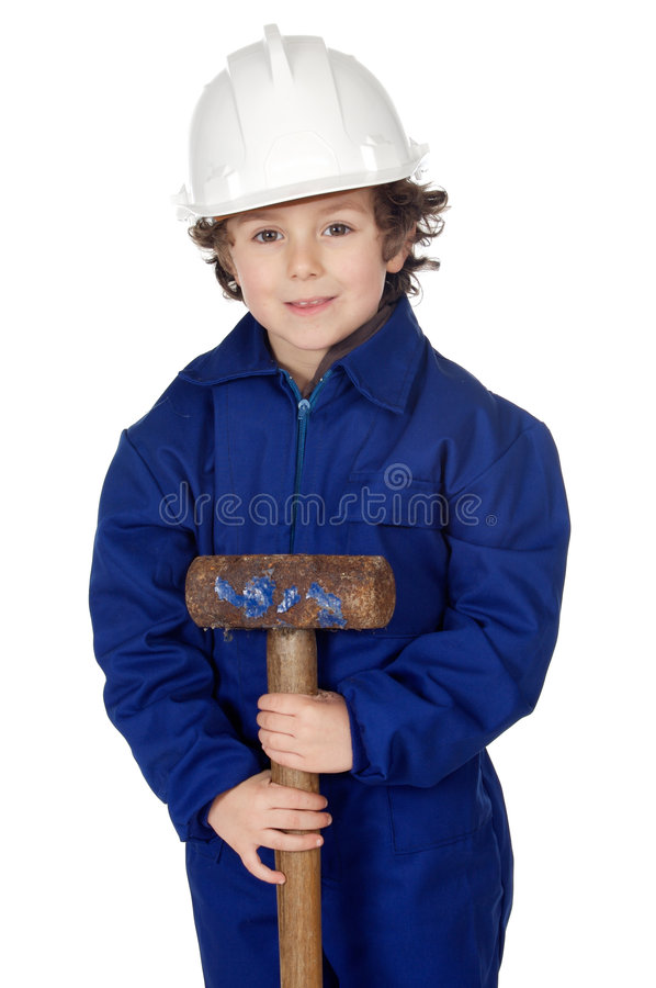 El muchacho adorable vistió al trabajador en un martillo y un casco foto de archivo libre de regalías
