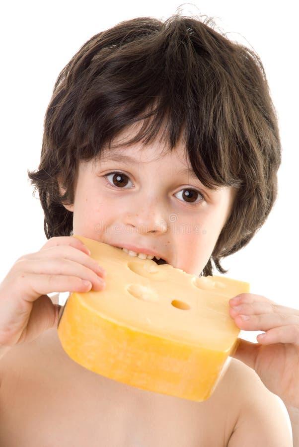 El muchacho con un queso fotos de archivo