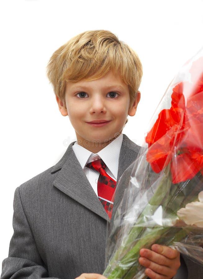 Download El muchacho con un ramo imagen de archivo. Imagen de niño - 1275957