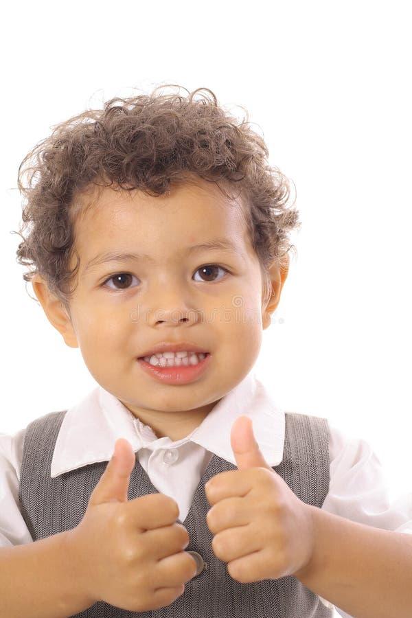 El muchacho del asunto manosea con los dedos para arriba foto de archivo