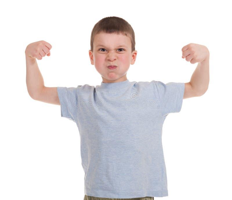 El muchacho muestra fuerza foto de archivo libre de regalías