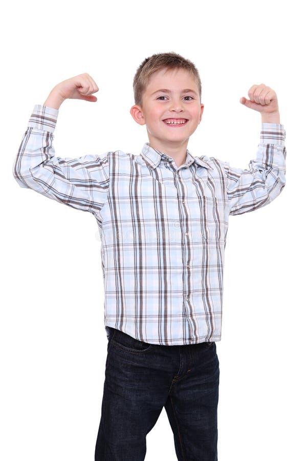 El muchacho sonriente fuerte foto de archivo libre de regalías