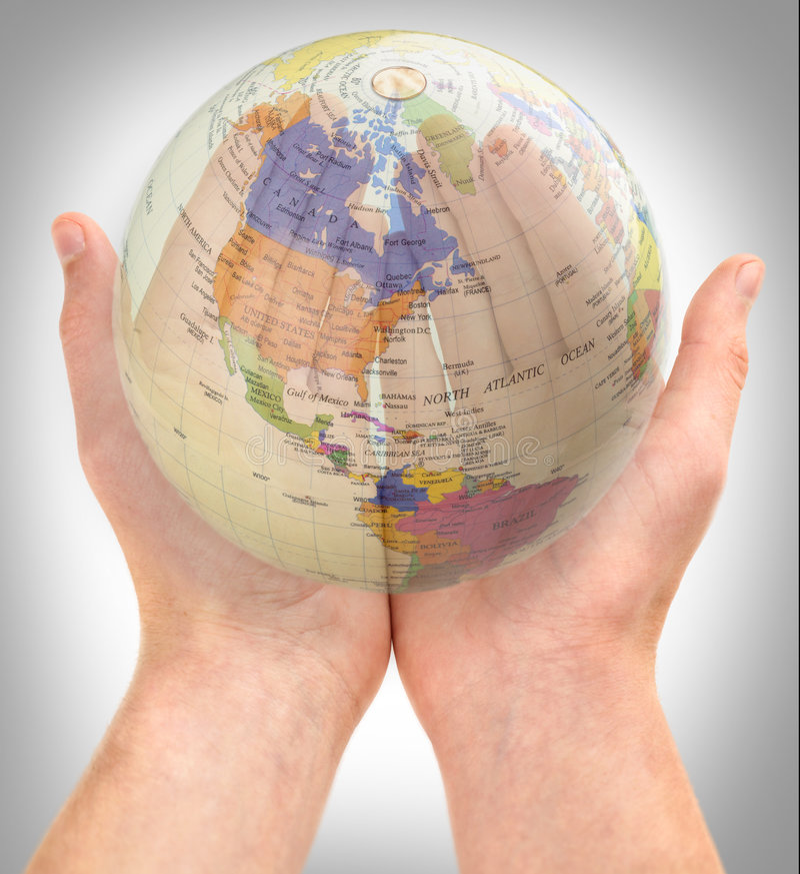 El mundo en nuestras manos imagen de archivo