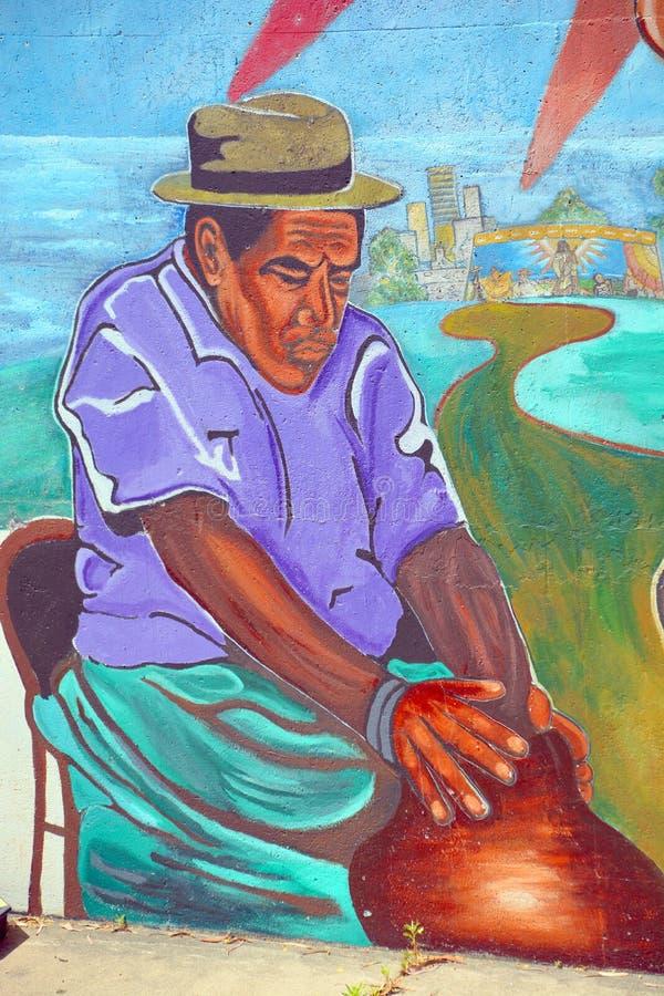 El mural cuenta la historia de la gente de los americanos de los mexicanos imagen de archivo