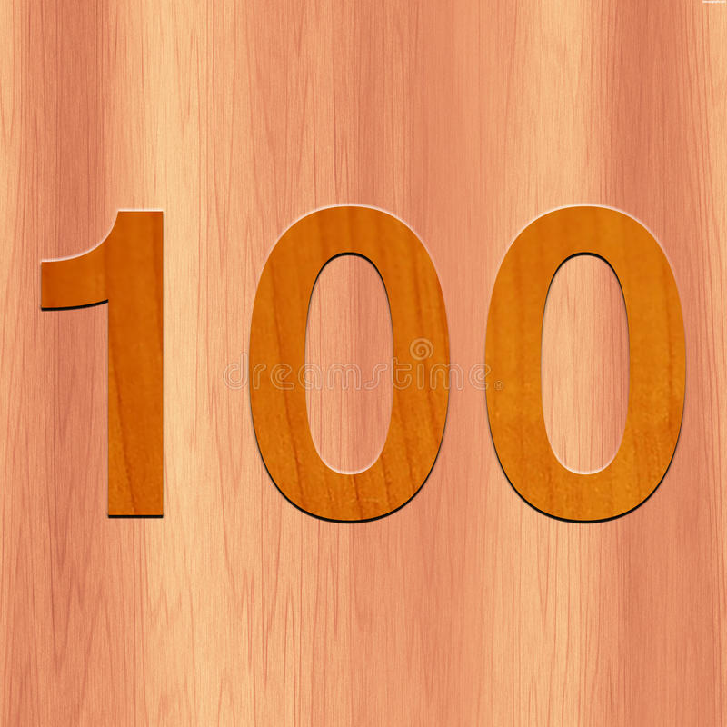 El número 100 hizo con madera en el fondo de madera imagenes de archivo