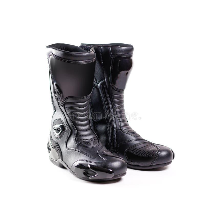 El negro se divierte las botas de motocicleta Aislado en un fondo blanco fotografía de archivo