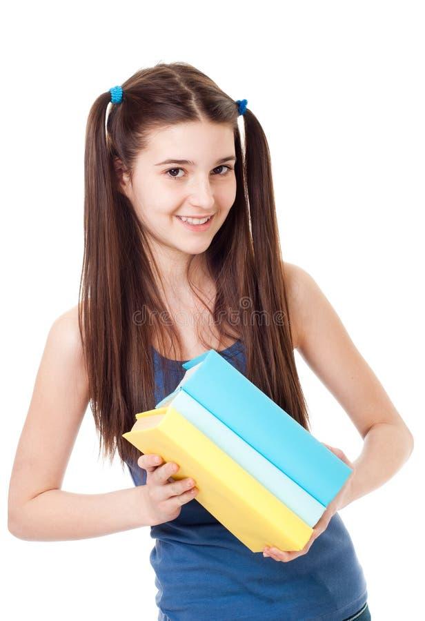 El niño de la muchacha con los libros imágenes de archivo libres de regalías