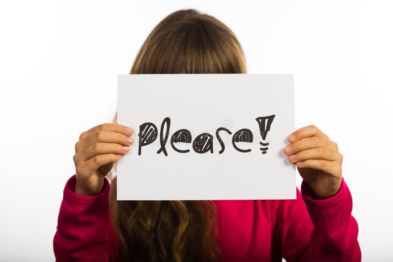 El niño que se sostiene por favor firma imágenes de archivo libres de regalías