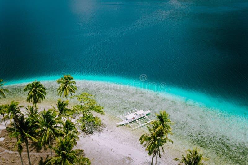 El Nido, Palawan, Philippines. Aerial drone view of tourist island hopping boats moored at tropical Ipil beach on. Pinagbuyutan Island stock photography