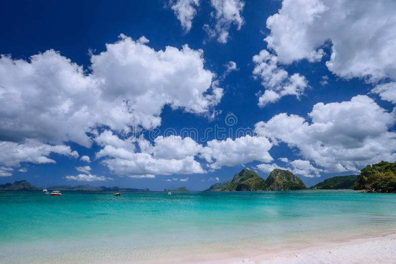 El Nido, Palawan, Philippines. Shallow lagoon bay , sandy beach and beautiful white cloudscape. Travel and vacation. Concept stock photography
