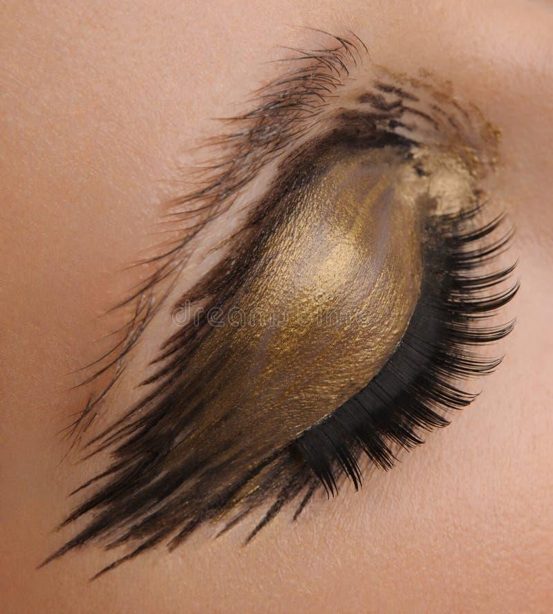 El ojo del encanto del oro compone fotografía de archivo
