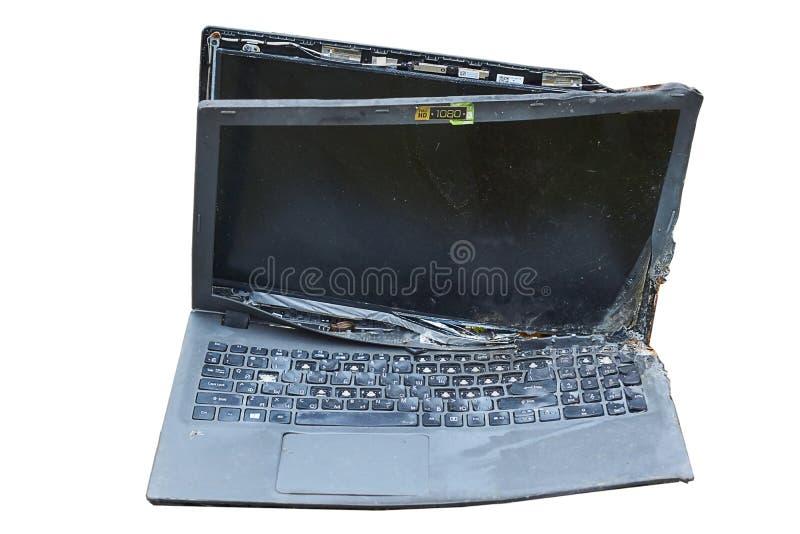 El ordenador portátil se quema en el fuego imagen de archivo libre de regalías