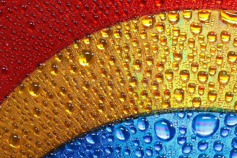 El oro azul y los colores rojos abstraen gotas del agua fotografía de archivo libre de regalías