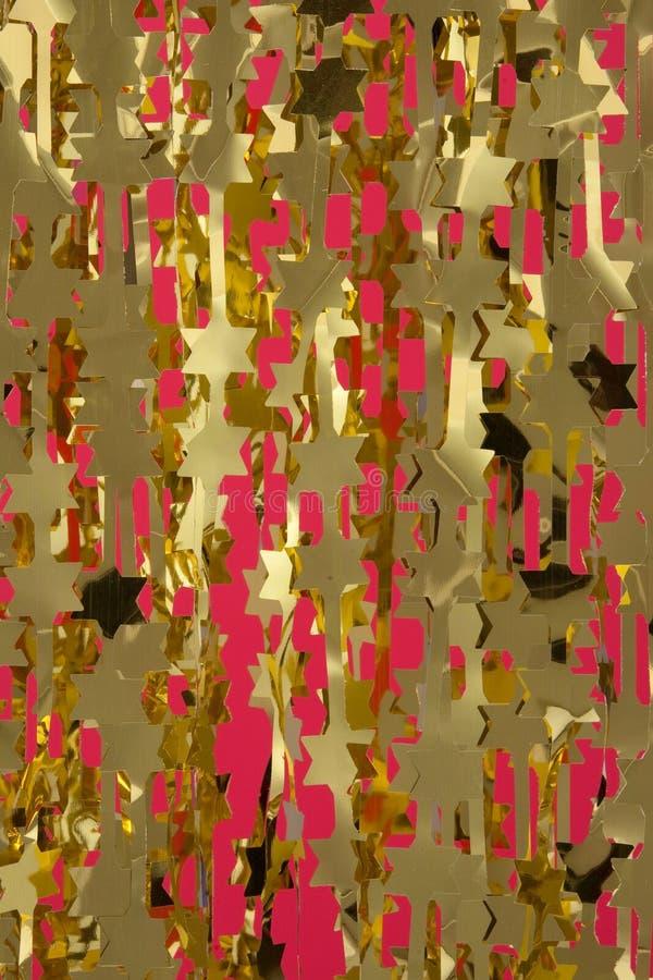 El oro de la decoración de la Navidad stars las guirnaldas imágenes de archivo libres de regalías