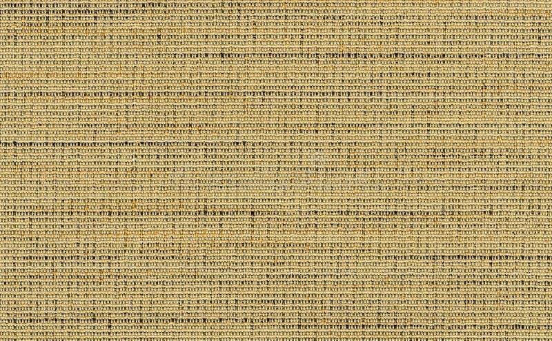 El oro del primer, amarillea con el contexto marrón oscuro de la textura de la tela de los colores Oro, muestra amarilla, de lino fotos de archivo