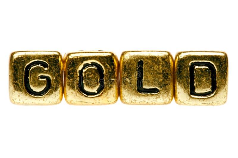 El oro deletrea el oro fotografía de archivo libre de regalías