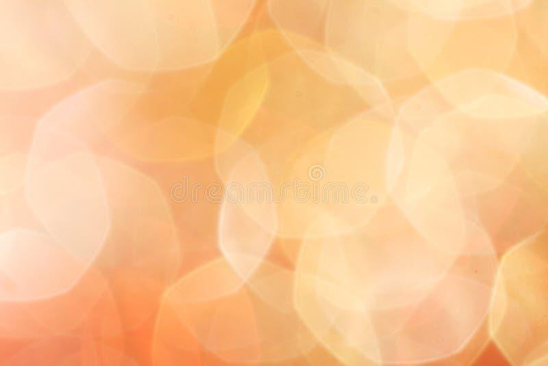 El oro, plata, rojo, blanco, bokeh abstracto anaranjado se enciende fotos de archivo