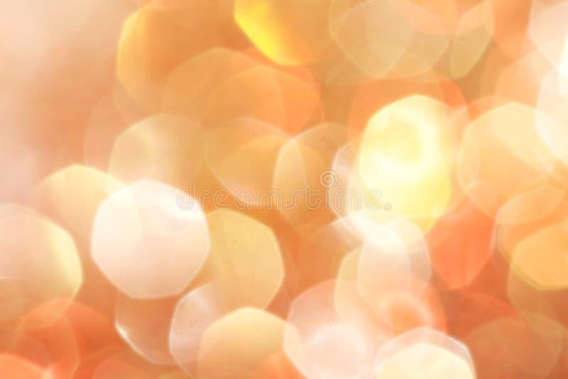 El oro, plata, rojo, blanco, bokeh abstracto anaranjado se enciende, fondo defocused imágenes de archivo libres de regalías