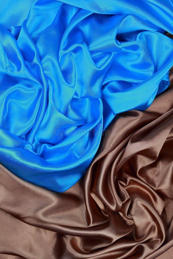 Download El Paño De Seda Azul Y Marrón Del Satén De Dobleces Ondulados Texturiza El Fondo Foto de archivo - Imagen de elegante, color: 64204020