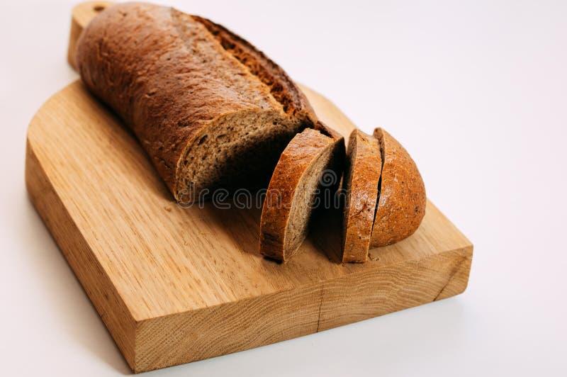 el pan de centeno entero Gluten-libre del grano cortó Pan hecho en casa libre del gluten Alimento sano imagen de archivo libre de regalías