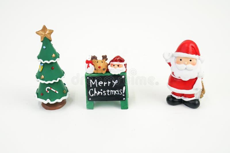 El Papá Noel y la otra figura juguete del modelo de la materia aislado en el fondo blanco fotos de archivo libres de regalías