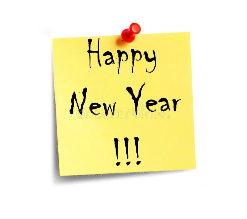 El papel amarillo con la Feliz Año Nuevo de la inscripción fotografía de archivo libre de regalías