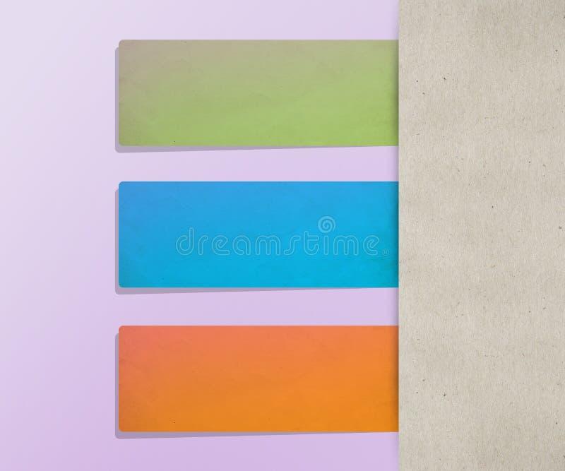 El papel coloreado marca el fondo con etiqueta fotografía de archivo