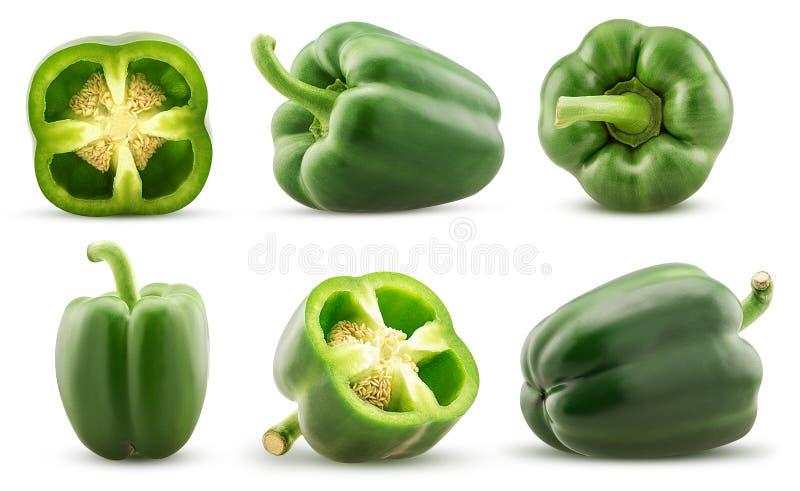El paprika verde determinado cortó por la mitad, entero imagen de archivo libre de regalías